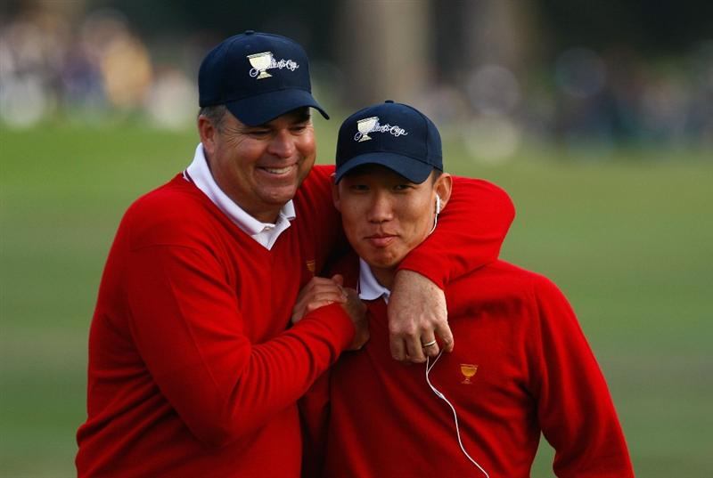 SAN FRANCISCO - OCTOBER 08:  (L-R)  Kenny Perry and Anthony Kim of the USA Team celebrate in the 18th fairway during the Day One Foursome Matches of The Presidents Cup at Harding Park Golf Course on October 8, 2009 in San Francisco, California.  (Photo by Scott Halleran/Getty Images)