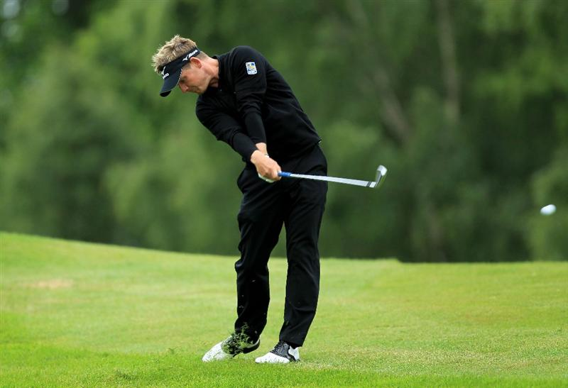 VIRGINIA WATER, ENGLAND - MAY 28:  Luke Donald of England hits his 2nd shot on the 1st hole during the third round of the BMW PGA Championship at the Wentworth Club on May 28, 2011 in Virginia Water, England.  (Photo by David Cannon/Getty Images)
