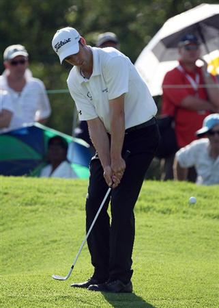 SUN CITY, SOUTH AFRICA - DECEMBER 05:  Ross Fisher of England chips at the 16th hole during the third round of the Nedbank Golf Challenge at the Gary Player Country Club at Sun City, on December 5, 2009 in Sun City, South Africa.  (Photo by David Cannon/Getty Images)