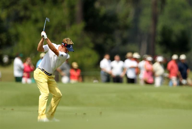 PONTE VEDRA BEACH, FL - MAY 13:  Luke Donald of England plays a shot on the fourth hole during the second round of THE PLAYERS Championship held at THE PLAYERS Stadium course at TPC Sawgrass on May 13, 2011 in Ponte Vedra Beach, Florida.  (Photo by Mike Ehrmann/Getty Images)