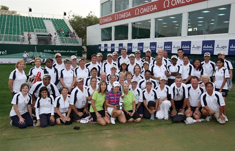 DUBAI, UNITED ARAB EMIRATES - DECEMBER 12:  In Kyung Kim of South Korea holds the trophy with the marshalls after the final round of the Dubai Ladies Masters, on the Majilis Course at the Emirates Golf Club on December 12, 2009 in Dubai, United Arab Emirates.  (Photo by David Cannon/Getty Images)