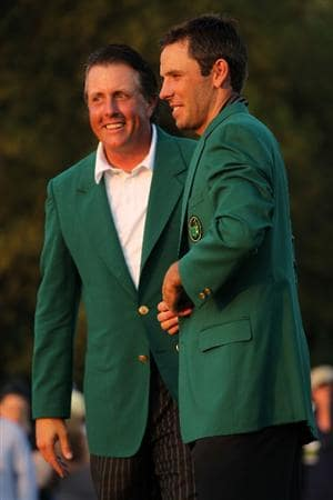 AUGUSTA, GA - APRIL 10:  Phil Mickelson presents Charl Schwartzel of South Africa the winner's jacket at the green jacket presentation after Schwartzel's two-stroke victory at the 2011 Masters Tournament at Augusta National Golf Club on April 10, 2011 in Augusta, Georgia.  (Photo by Jamie Squire/Getty Images)
