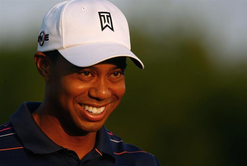 CHASKA, MN - AUGUST 11:  Tiger Woods smiles during the second preview day of the 91st PGA Championship at Hazeltine Golf Club on August 11, 2009 in Chaska, Minnesota.  (Photo by Scott Halleran/Getty Images)