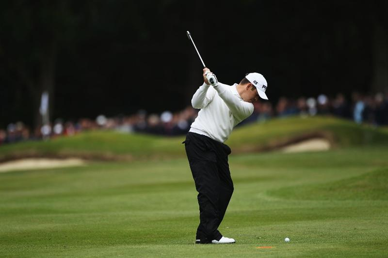 VIRGINIA WATER, ENGLAND - MAY 27:  Louis Oosthuizen of South Africa hits an approach shot on the 5th hole during the second round of the BMW PGA Championship at the Wentworth Club on May 27, 2011 in Virginia Water, England.  (Photo by Warren Little/Getty Images)