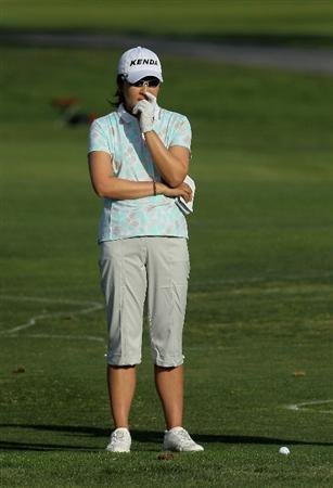 CARLSBAD, CA - MARCH 27:  Candie Kung of Taiwan considers her third shot on the 18th hole during the third round of the Kia Classic Presented by J Golf at La Costa Resort and Spa on March 27, 2010 in Carlsbad, California. (Photo by Stephen Dunn/Getty Images)