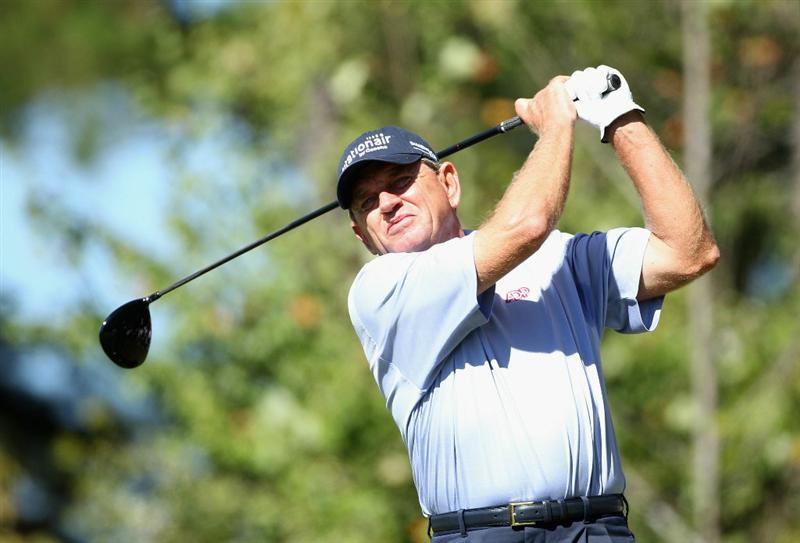CONOVER, NC - OCTOBER 02:  Nick Price of Zimbabwe hits a tee shot on the fourth hole during the second round of the Ensure Classic at the Rock Barn Golf & Spa on October 2, 2010 in Conover, North Carolina.  (Photo by Christian Petersen/Getty Images)
