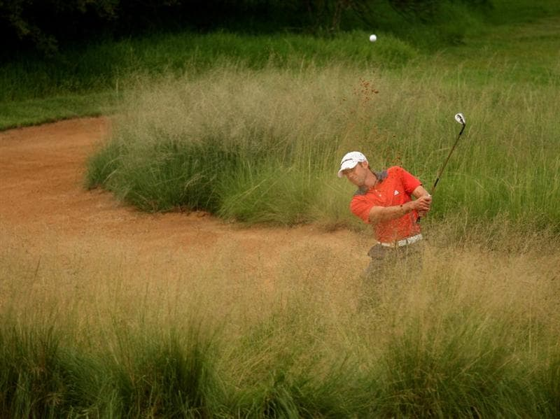 SUN CITY, SOUTH AFRICA - DECEMBER 04:  Sergio Garcia of Spain plays from the waste area between the deep grass on the 14th during the first round of the Nedbank Golf Challenge at the Gary Player Country Club on December 4, 2008 in Sun City, South Africa.  (Photo by Richard Heathcote/Getty Images)