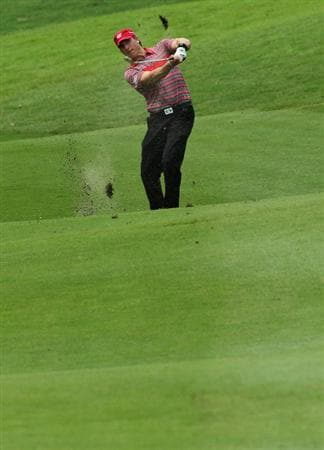 KUALA LUMPUR, MALAYSIA - OCTOBER 31: Ricky Barnes of USA plays his 2nd shot on the 18th hole during day four of the CIMB Asia Pacific Classic at The MINES Resort & Golf Club on October 31, 2010 in Kuala Lumpur, Malaysia. (Photo by Stanley Chou/Getty Images)