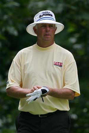 SILVIS, IL - JULY 09:  Kirk Triplett of the USA prepares to hit a shot during the first round of the John Deere Classic at TPC Deere Run held on July 9, 2009 in Silvis, Illinois.  (Photo by Michael Cohen/Getty Images)