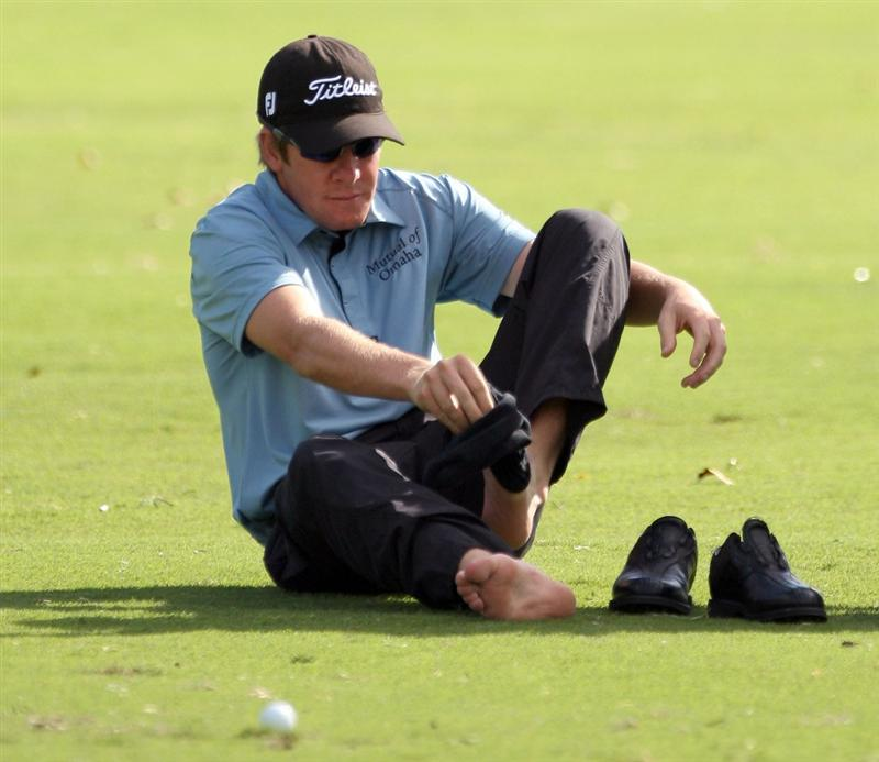 HONOLULU - JANUARY 15:  Aron Price of Australia changes socks on the 14th hole during the first round of the Sony Open at Waialae Country Club on January 15, 2009 in Honolulu, Hawaii.  (Photo by Sam Greenwood/Getty Images)