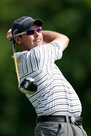 CHASKA, MN - AUGUST 13: Rich Beem hits his tee shot on the third hole during the first round of the 91st PGA Championship at Hazeltine National Golf Club on August 13, 2009 in Chaska, Minnesota.  (Photo by Jamie Squire/Getty Images)