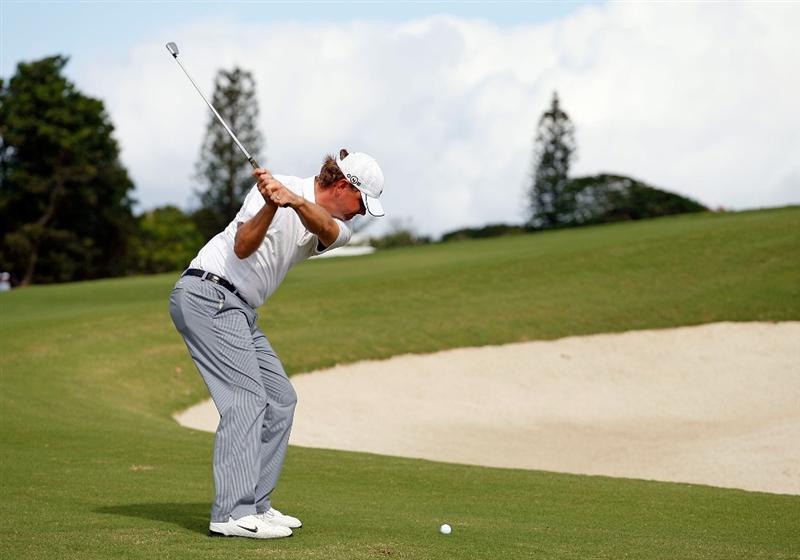 SOUTHAMPTON, BERMUDA - OCTOBER 20:  Lucas Glover hits his second shot on the 2nd hole during the first round of the PGA Grand Slam of Golf on October 20, 2009 Port Royal Golf Course in Southampton, Bermuda.  (Photo by Andy Lyons/Getty Images)