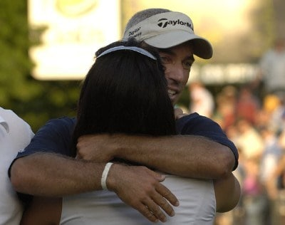 Corey Pavin greets his wife Lisa after winning the U.S. Bank Championship in Milwaukee at Brown Deer Park Golf Course in Milwaukee, Wisconsin, on July 30, 2006.Photo by Steve Levin/WireImage.com
