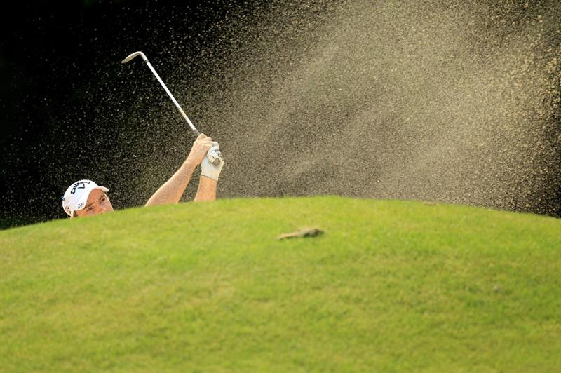VIRGINIA WATER, ENGLAND - MAY 20:  Oliver Wilson of England hits his out of a bunker on the 16th hole during the first round of the BMW PGA Championship on the West Course at Wentworth on May 20, 2010 in Virginia Water, England.  (Photo by Warren Little/Getty Images)