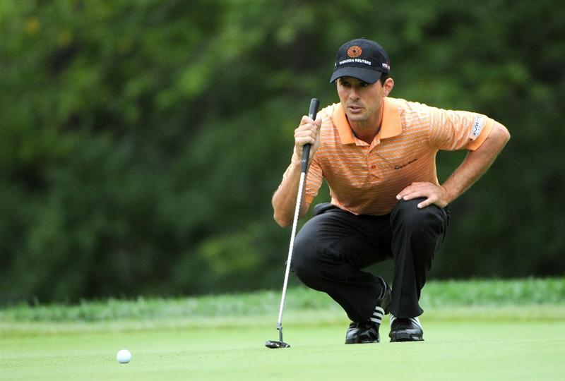 ST. LOUIS - SEPTEMBER 5:  Mike Weir lines up a birdie putt on the 10th hole during the rain delayed first round of the BMW Championship held at Bellerive Country Club on September 5, 2008 in St. Louis, Missouri.  (Photo by Marc Feldman/Getty Images)