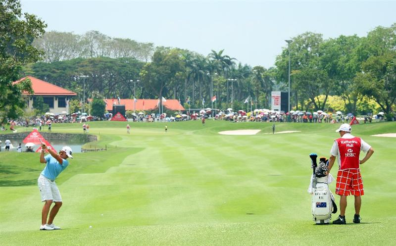 SINGAPORE - MARCH 08:  Katherine Hull of Australia hits her second shot on the ninth hole during the final round of the HSBC Women's Champions at Tanah Merah Country Club on March 8, 2009 in Singapore.  (Photo by Andrew Redington/Getty Images)