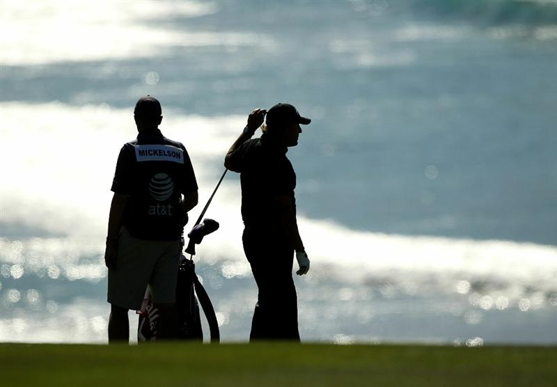 PEBBLE BEACH, CA - FEBRUARY 12:  Phil Mickelson waits to hit his second shot on the 9th hole during the third round of the AT&T Pebble Beach National Pro-Am at the Pebble Beach Golf Links on February 12, 2011 in Pebble Beach, California.  (Photo by Ezra Shaw/Getty Images)