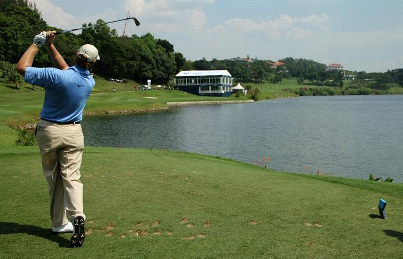 KUALA LUMPUR, MALAYSIA - OCTOBER 28: Ernie Els of South Africa tees off on the 16th hole during day one of the CIMB Asia Pacific Classic at The MINES Resort & Golf Club on October 28, 2010 in Kuala Lumpur, Malaysia. (Photo by Stanley Chou/Getty Images)