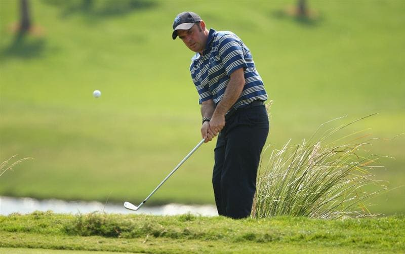 BANGKOK, THAILAND - JANUARY 11:  Paul McGinley of Ireland plays a shot during The Royal Trophy at the Amata Spring Country Club on January 11, 2009 in Bangkok, Thailand.  (Photo by Ian Walton/Getty Images)