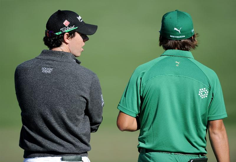 AUGUSTA, GA - APRIL 07:  Rory McIlroy of Northern Ireland (L) and Rickie Fowler wait on the second green during the first round of the 2011 Masters Tournament at Augusta National Golf Club on April 7, 2011 in Augusta, Georgia.  (Photo by Harry How/Getty Images)