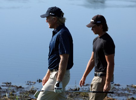 CHAMPIONS GATE, FLORIDA - DECEMBER 02: Greg Norman and his son Gregory Norman walk to the 5th green during the final round of the 2007 Del Webb Father Son Challenge on the International Course at Champions Gate Golf Club, on December 2, 2007 in Champions Gate, Florida.  (Photo by David Cannon/Getty Images)