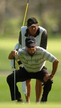 Mark McNulty and his caddy line up a putt on the 13th green during the second round of the Champions' Tour 2005 SBC Classic at  the Valencia Country Club in Valencia, California March 12, 2005.