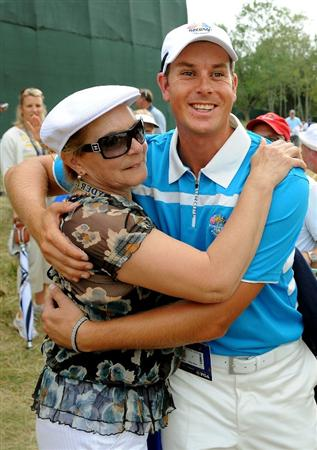 LOUISVILLE, KY - SEPTEMBER 20:  Oliver Wilson of the European team hugs his mother after his morning foursome match on day two of the 2008 Ryder Cup at Valhalla Golf Club on September 20, 2008 in Louisville, Kentucky.  (Photo by Harry How/Getty Images)