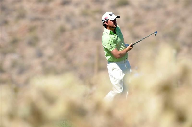 MARANA, AZ - FEBRUARY 25:  Graeme McDowell of Northern Ireland hits his approach shot on the ninth hole during the third round of the Accenture Match Play Championship at the Ritz-Carlton Golf Club on February 25, 2011 in Marana, Arizona.  (Photo by Stuart Franklin/Getty Images)