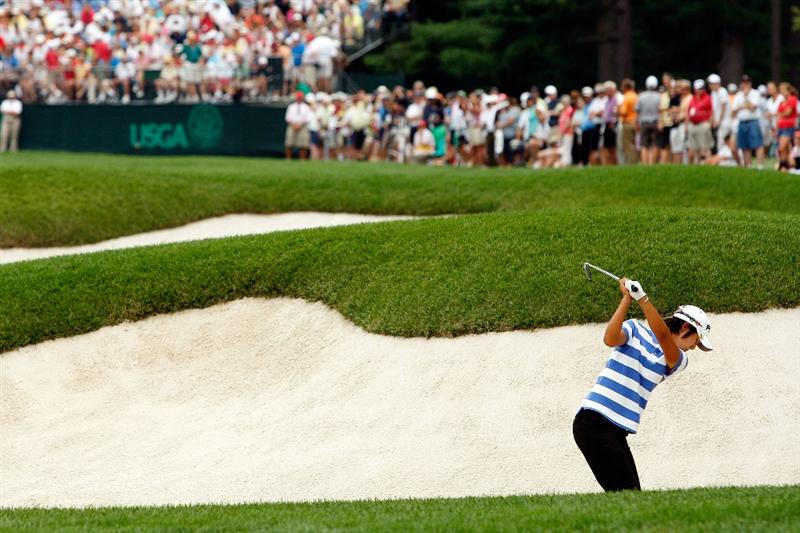 BETHLEHEM, PA - JULY 11:  Song-Hee Kim of South Korea tees hits out of a bunker on the 8th hole during the third round of the 2009 U.S. Women's Open at Saucon Valley Country Club on July 11, 2009 in Bethlehem, Pennsylvania.  (Photo by Chris Graythen/Getty Images)