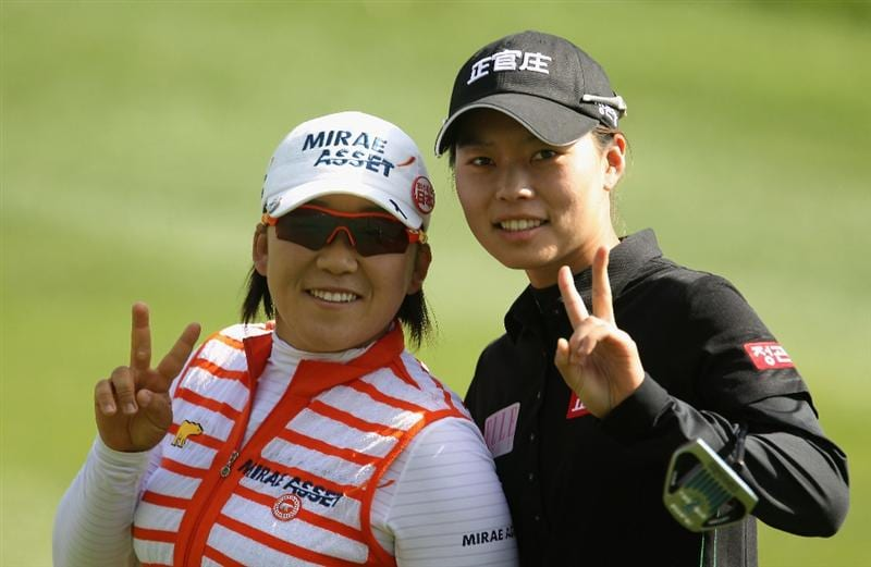 CITY OF INDUSTRY, CA - MARCH 25:  Jiyai Shin (L) and Sun Young Yoo of South Korea wait in the 12th fairway during the second round of the Kia Classic on March 25, 2011 at the Industry Hills Golf Club in the City of Industry, California.  (Photo by Scott Halleran/Getty Images)