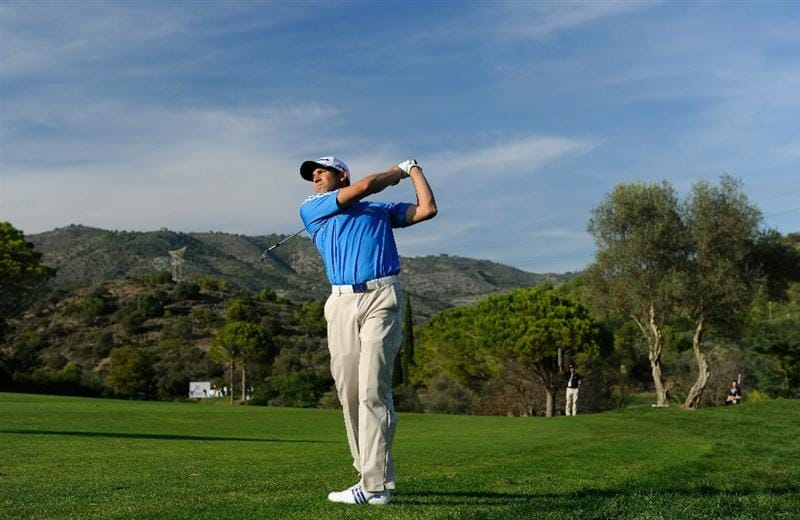 CASTELLON DE LA PLANA, SPAIN - OCTOBER 22:  Sergio Garcia of Spain plays his approach shot on the 15th hole during the second round of the Castello Masters Costa Azahar at the Club de Campo del Mediterraneo on October 22, 2010 in Castellon de la Plana, Spain.  (Photo by Stuart Franklin/Getty Images)