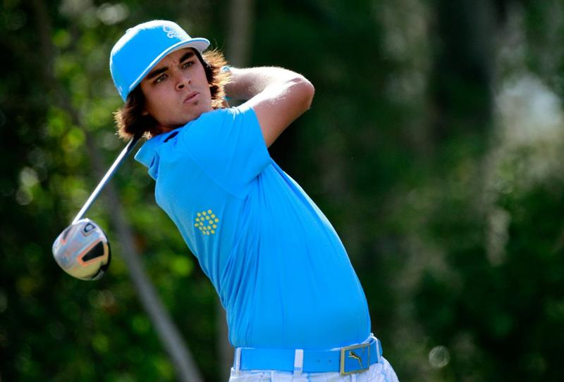 LAKE BUENA VISTA, FL - NOVEMBER 12:  Rickie Fowler plays a shot on the 4th hole during the second round of the Children's Miracle Network Classic at the Disney Palm and Magnolia course on November 12, 2010 in Lake Buena Vista, Florida.  (Photo by Sam Greenwood/Getty Images)