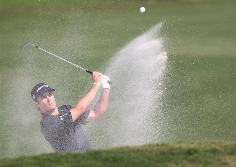 DORAL, FL - MARCH 12:  Kevin Streelman hits a bunker  shot on the fourth hole during the third round of the 2011 WGC- Cadillac Championship at the TPC Blue Monster at the Doral Golf Resort and Spa on March 12, 2011 in Doral, Florida.  (Photo by Sam Greenwood/Getty Images)