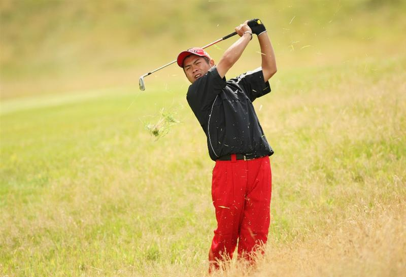 TURNBERRY, SCOTLAND - JULY 16:  Yuta Ikeda of Japan hits from the rough during round one of the 138th Open Championship on the Ailsa Course, Turnberry Golf Club on July 16, 2009 in Turnberry, Scotland.  (Photo by Ross Kinnaird/Getty Images)