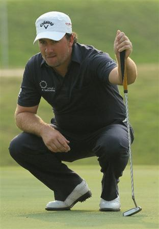 HONG KONG - NOVEMBER 19: Graeme Mcdowell of Northern Ireland lines up for a putt on the 14th hole during day two of the UBS Hong Kong Open at The Hong Kong Golf Club on November 19, 2010 in Hong Kong, Hong Kong.  (Photo by Stanley Chou/Getty Images)