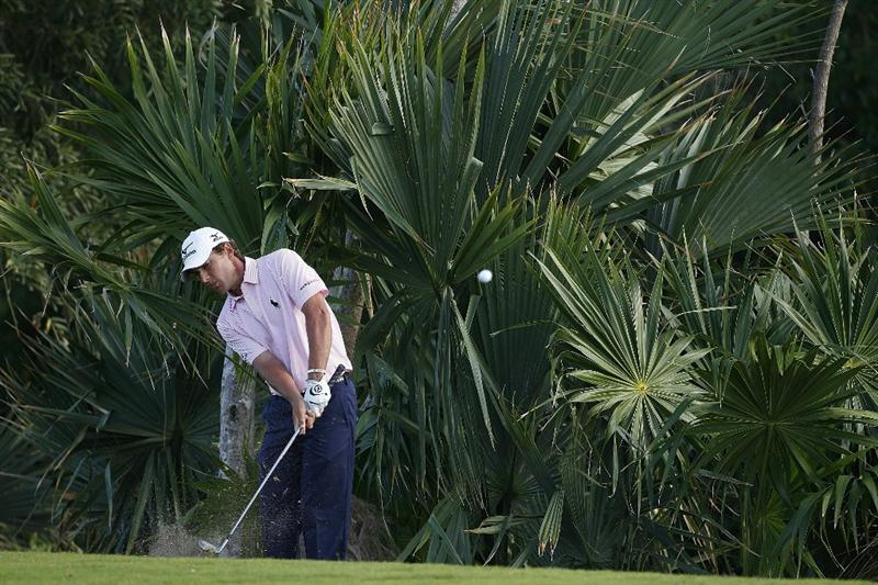 PLAYA DEL CARMEN, MEXICO - FEBRUARY 25:  Charles Howell III hits a shot from the rough during the second round of the Mayakoba Golf Classic at Riviera Maya-Cancun held at El Camaleon Golf Club on February 25, 2011 in Playa del Carmen, Mexico.  (Photo by Michael Cohen/Getty Images)