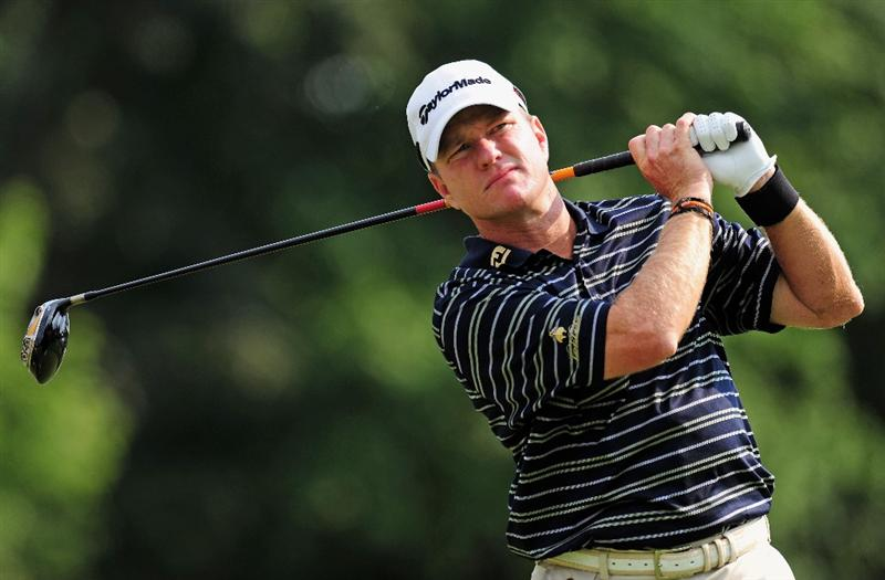 AKRON, OH - AUGUST 06:  Scott Verplank of the U.S. plays his tee shot on the eighth hole during the first round of the World Golf Championship Bridgestone Invitational on August 6, 2009 at Firestone Country Club in Akron, Ohio.  (Photo by Stuart Franklin/Getty Images)