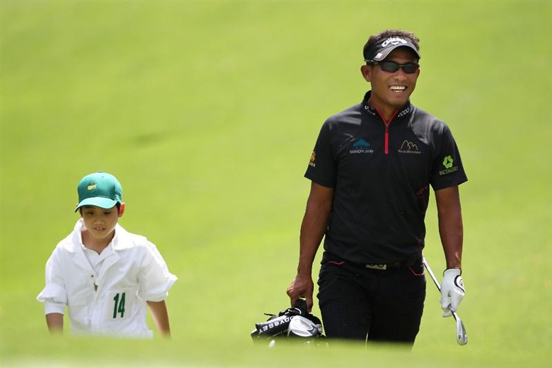 AUGUSTA, GA - APRIL 07:  Thongchai Jaidee of Thailand walks with his caddie during the Par 3 Contest prior to the 2010 Masters Tournament at Augusta National Golf Club on April 7, 2010 in Augusta, Georgia.  (Photo by Jamie Squire/Getty Images)