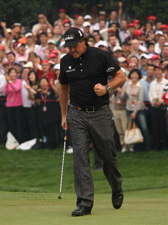 SHANGHAI, CHINA - NOVEMBER 08:  Phil Mickelson of the USA celebrates a par putt on the 16th green during the final round of the WGC-HSBC Champions at Sheshan International Golf Club on November 8, 2009 in Shanghai, China.  (Photo by Andrew Redington/Getty Images)