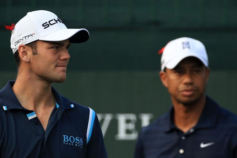 PONTE VEDRA BEACH, FL - MAY 12:  Martin Kaymer of Germany (L) and Tiger Woods (R) look on from the first hole tee box during the first round of THE PLAYERS Championship held at THE PLAYERS Stadium course at TPC Sawgrass on May 12, 2011 in Ponte Vedra Beach, Florida.  (Photo by Streeter Lecka/Getty Images)