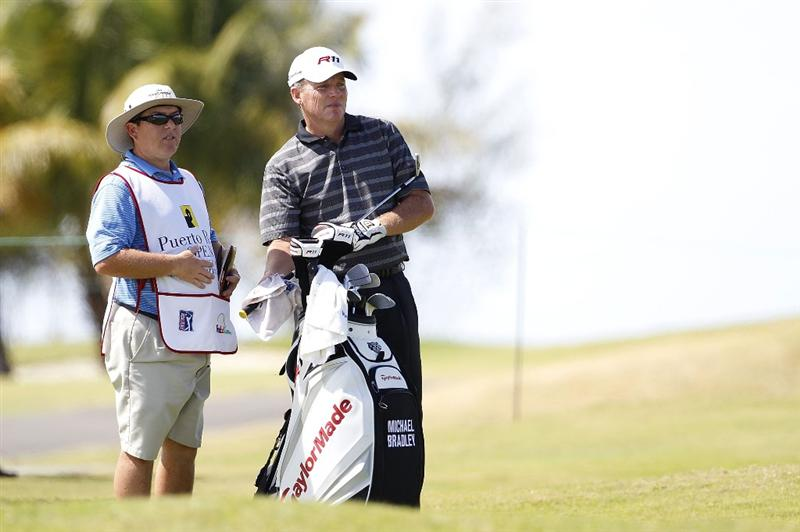 RIO GRANDE, PR - MARCH 13:  Michael Bradley (R) stands by his golf bag on the 13th fairwayduring the final round of the Puerto Rico Open presented by seepuertorico.com at Trump International Golf Club on March 13, 2011 in Rio Grande, Puerto Rico.  (Photo by Michael Cohen/Getty Images)