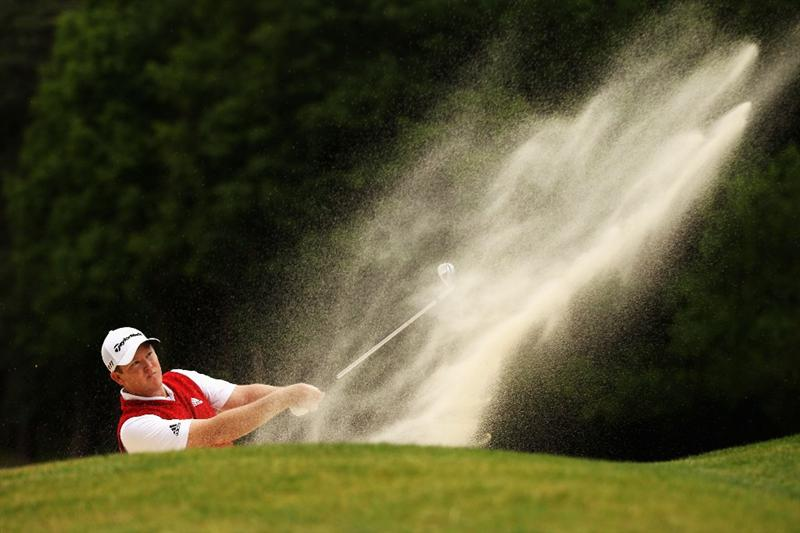 VIRGINIA WATER, ENGLAND - MAY 29:  Marcus Fraser of Australia plays out of a bunker on the 13th during the final round of the BMW PGA Championship  at the Wentworth Club on May 29, 2011 in Virginia Water, England.  (Photo by Richard Heathcote/Getty Images)