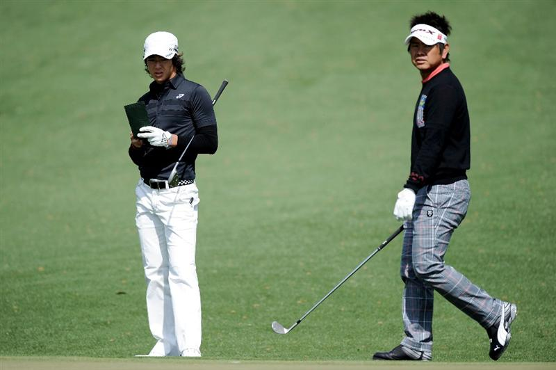 AUGUSTA, GA - APRIL 05:  Ryo Ishikawa (L) and Hiroyuki Fujita of Japan look on from a green during a practice round prior to the 2011 Masters Tournament at Augusta National Golf Club on April 5, 2011 in Augusta, Georgia.  (Photo by Harry How/Getty Images)