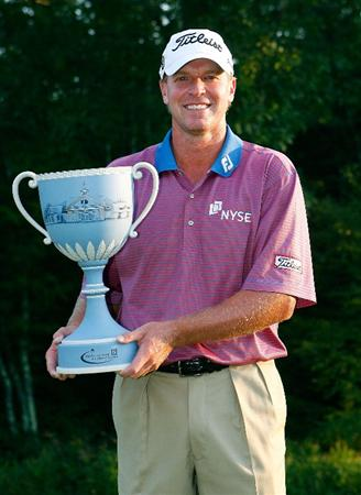 NORTON, MA - SEPTEMBER 7:  Steve Stricker holds the champion's trophy after the final round of the Deutsche Bank Championship at TPC Boston on September 7, 2009 in Norton, Massachusetts. (Photo by Jim Rogash/Getty Images)