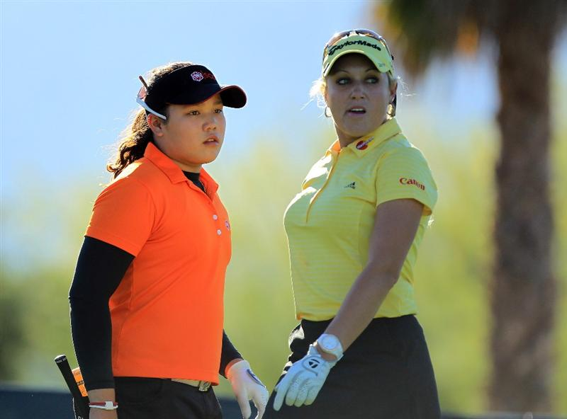RANCHO MIRAGE, CA - MARCH 31:  Natalie Gulbis of the USA is watched by her playing partner Ariya Jutanugarn of Thailand after she played her tee shot at the par 3, 8th hole during the first round of the 2011 Kraft Nabisco Championship on the Dinah Shore Championship Course at the Mission Hills Country Club on March 31, 2011 in Rancho Mirage, California.  (Photo by David Cannon/Getty Images)