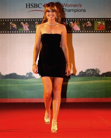 SINGAPORE - MARCH 04:  Paula Creamer of the USA walks down the runway during the Gala Dinner prior to the start of the HSBC Women's Champions at Tanah Merah Country Club on March 4, 2009 in Singapore.  (Photo by Andrew Redington/Getty Images)