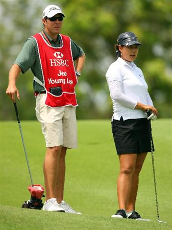 SINGAPORE - MARCH 04:  Jee Young Lee of Korea waits to hit her second shot on the ninth hole during the Pro-Am prior to the start of the HSBC Women's Champions at Tanah Merah Country Club on March 4, 2009 in Singapore.  (Photo by Andrew Redington/Getty Images)