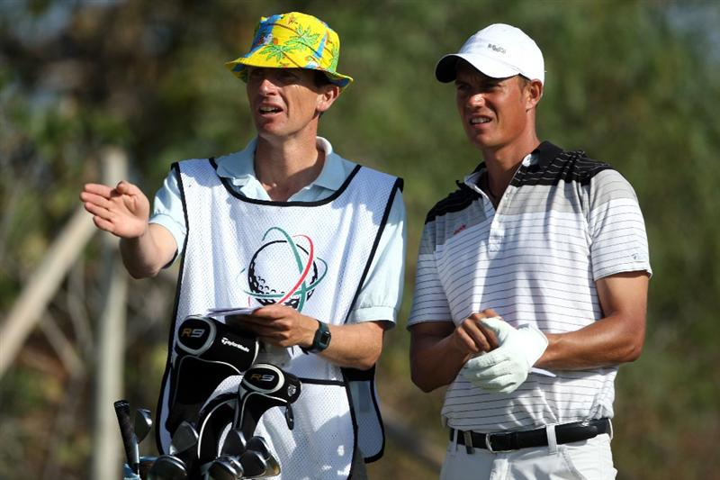 VILAMOURA, PORTUGAL - OCTOBER 16:  Mads Vibe-Hastrup of Denmark waits with his caddie on the fourth hole during the second round of the Portugal Masters at the Oceanico Victoria Golf Course on October 16, 2009 in Vilamoura, Portugal.  (Photo by Andrew Redington/Getty Images)