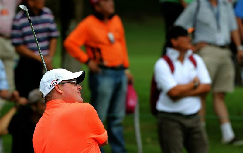 KUALA LUMPUR, MALAYSIA - OCTOBER 31: Carl Pettersson of Sweden watches his 2nd shot on the 13th hole during day four of the CIMB Asia Pacific Classic at The MINES Resort & Golf Club on October 31, 2010 in Kuala Lumpur, Malaysia. (Photo by Stanley Chou/Getty Images)