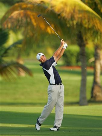 RIO GRANDE, PR - MARCH 14:  Chad Collins hits his second shot on the third fairway during the third round of the Puerto Rico Open presented by Banco Popular at Trump International Golf Club held on March 14, 2010 in Rio Grande, Puerto Rico.  (Photo by Michael Cohen/Getty Images)